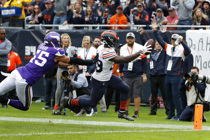 Chicago Bears running back Tarik Cohen, right, scores past Minnesota Vikings outside linebacker Anthony Barr (55) during the half of an NFL football game Sunday, Sept. 29, 2019, in Chicago. (AP Photo/Charles Rex Arbogast)
