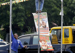Manila City public workers remove the campaign posters, mostly that of incumbent Mayor and former President Joseph