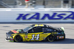 Clint Bowyer (14) takes a lap during practice for a NASCAR Cup Series auto race at Kansas Speedway in Kansas City, Kan., Friday, Oct. 18, 2019. (AP Photo/Colin E. Braley)