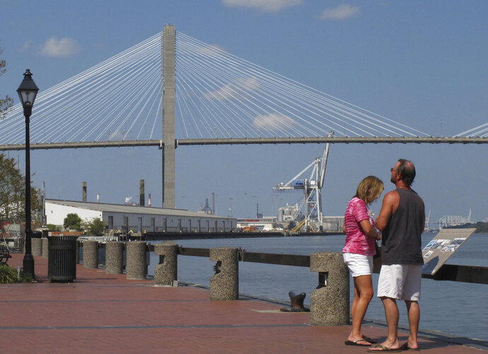 FILE - This Sept. 28, 2017 file photo shows the Eugene Talmadge Memorial Bridge over the Savannah river, in Savannah, Ga.  The Girl Scouts have hired a lobbyist, met with the governor and made plans for a milk-and-cookies reception for Georgia lawmakers as they try to get a Savannah bridge renamed for Girl Scouts founder Juliette Gordon Low.  Sue Else of the Girls Scouts of Historic Georgia says up to 300 scouts will visit the state Capitol in February 2018 to meet with lawmakers about the bridge.   (AP Photo/Russ Bynum)