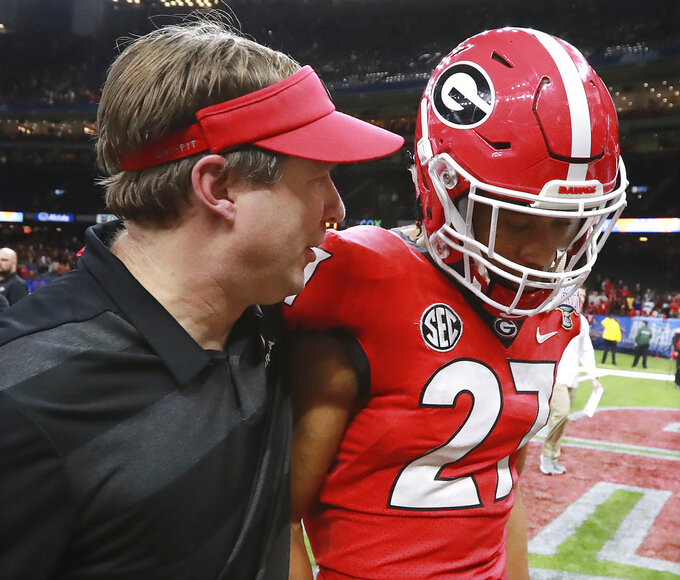 Georgia coach Kirby Smart consoles defensive back Eric Stokes after the team's 28-21 loss to Texas during the Sugar Bowl NCAA college football game Tuesday, Jan. 1, 2019, in New Orleans. (Curtis Compton/Atlanta Journal Constitution via AP)