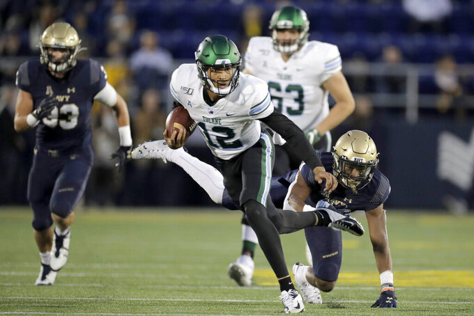 Tulane quarterback Justin McMillan (12) runs with the ball while avoiding a hit from Navy cornerback Cameron Kinley during the second half of an NCAA college football game, Saturday, Oct. 26, 2019, in Annapolis. Navy won 41-38. (AP Photo/Julio Cortez)