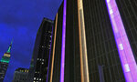The exterior of Madison Square Garden, right, is lit in gold and purple, the Los Angeles Lakers colors, as the Empire State Building is at left, in the wake of the death of retired NBA star Kobe Bryant before the start of a basketball game between the Brooklyn Nets and the New York Knicks, Sunday, Jan. 26, 2020, in New York. (AP Photo/Kathy Willens)