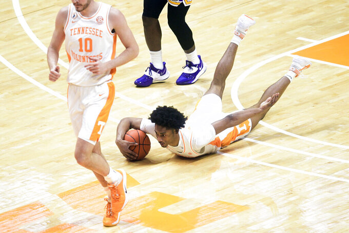Tennessee's Keon Johnson (45) slides on the court during an NCAA college basketball game against Tennessee Tech Friday, Dec. 18, 2020, in Knoxville, Tenn. (Caitie McMekin/Knoxville News Sentinel via AP, Pool)