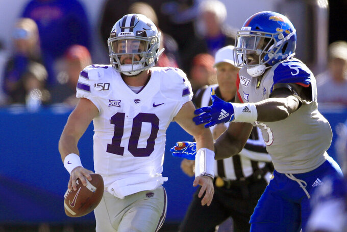 Kansas State quarterback Skylar Thompson (10) out runs Kansas linebacker Azur Kamara (5) during the first half of an NCAA college football game in Lawrence, Kan., Saturday, Nov. 2, 2019. (AP Photo/Orlin Wagner)