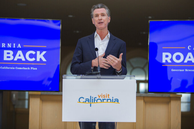 """California Gov. Gavin Newsom speaks during a press conference in San Francisco on Monday, June 14, 2021. California will offer six """"dream vacation"""" incentives to spur more people to get coronavirus vaccinations, Gov. Gavin Newsom said Monday on the eve of the state's awarding of $15 million in cash prizes. Goodies in the package include floor seats at an NBA game with the LA Lakers, and tickets to Disneyland, Legoland, SeaWorld and a symphony, he said. (Nina Riggio/San Francisco Chronicle via AP)"""