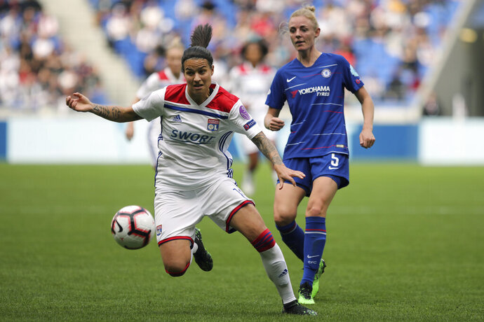 Lyon's Delphine Cascarino, left, challenges for the ball with Chelsea's Sophie Ingle, right, during their Women's Champions League semifinal soccer match in Decines, France, Sunday, April 21, 2019. (AP Photo/Laurent Cipriani)