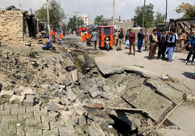 Afghan security personnel and Municipality workers work at the site of an explosion in Kabul, Afghanistan, Wednesday, Sept. 9, 2020. Spokesman for Afghanistan's Interior Ministry said the bombing that targeted the convoy of the country's first vice president on Wednesday morning killed several people and wounded more than a dozen others, including several of the vice president's bodyguards.(AP Photo/Rahmat Gul)