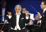 "FILE - In this file photo taken on Aug. 28, 2019, Opera star Placido Domingo performs during a concert in Szeged, Hungary. The 78-year-old singer who rose to stardom as a tenor has been confirmed to sing the baritone title role in ""Nabucco"" at the Zurich Opera House this Sunday. It will be his first time performing since stepping down Oct. 2 as general director of the Los Angeles Opera and withdrawing from future performances at the company. (AP Photo/Laszlo Balogh)"