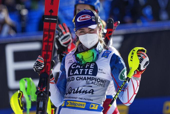 United States' Mikaela Shiffrin celebrates her third place in the women's slalom, at the alpine ski World Championships in Cortina d'Ampezzo, Italy, Saturday, Feb. 20, 2021. (AP Photo/Giovanni Auletta)
