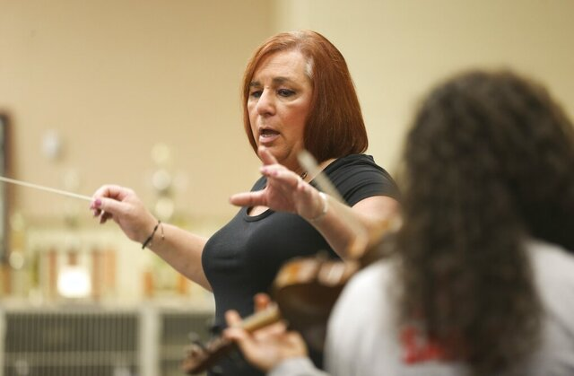 Stephanie Byers conducts a band class at Wichita North High on April 23, 2018. Byers ran unopposed and won Tuesday's Democratic primary in the 86th District of the Kansas House of Representatives. Byers has since retired from teaching. (Jaime Green/The Wichita Eagle via AP)