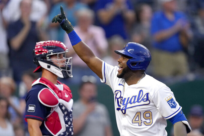 Kansas City Royals' Hanser Alberto (49) celebrates as he crosses the plate after hitting a two-run home run during the third inning of a baseball game against the Minnesota Twins Friday, July 2, 2021, in Kansas City, Mo. (AP Photo/Charlie Riedel)