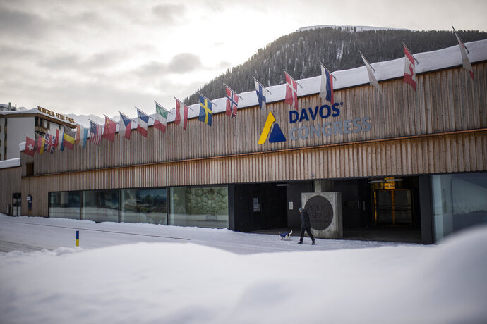 Exterior view of the congress center in Davos, Switzerland, Monday, Jan. 25, 2021. The World Economic Forum, WEF, was scheduled to take place in Davos between Jan. 25 and Jan. 29, 2021. Due to the Coronavirus outbreak it will be held in a digital format. (Gian Ehrenzeller/Keystone via AP)