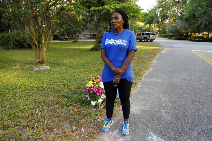 In this May 17, 2020, photo, Wanda Cooper-Jones stands near the spot where her 25-year-old son Ahmaud Arbery was shot and killed while jogging through a Brunswick, Ga., neighborhood. She says her son ran every day to clear his mind. (AP Photo/Sarah Blake Morgan)