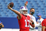 Buffalo Bills quarterback Josh Allen throws a pass during pregame warmups on the ninth day of NFL football training camp at Bills Stadium in Orchard Park, N.Y., Thursday, Aug. 27, 2020. (James P. McCoy/Buffalo News via AP, Pool)