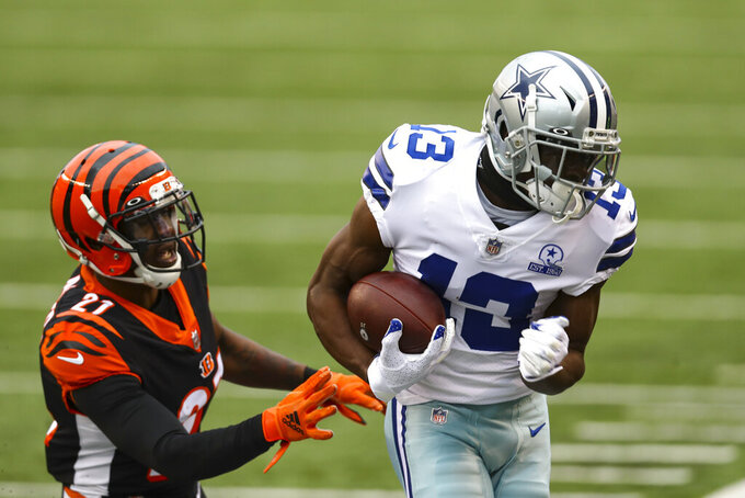 Dallas Cowboys wide receiver Michael Gallup (13) makes a catch in front of Cincinnati Bengals cornerback Mackensie Alexander (21) in the first half of an NFL football game in Cincinnati, Sunday, Dec. 13, 2020. (AP Photo/Aaron Doster)