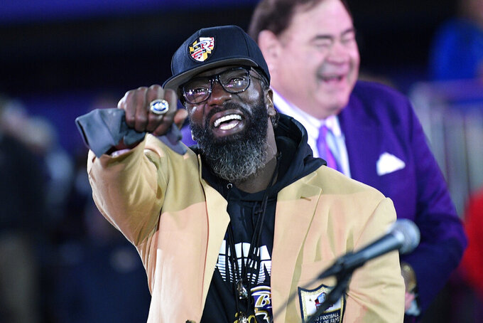 Former Baltimore Ravens safety Ed Reed displays his Pro Football Hall of Fame ring during a ceremony at halftime of an NFL football game between the Baltimore Ravens and the New England Patriots, Sunday, Nov. 3, 2019, in Baltimore. (AP Photo/Nick Wass)