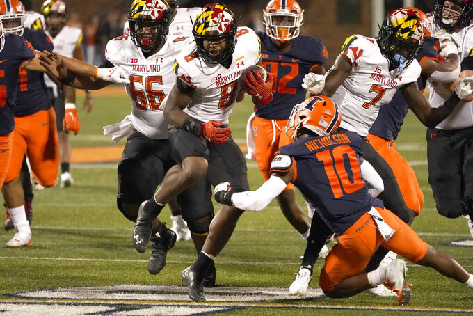 Maryland running back Tayon Fleet-Davis (8) carries the ball during the first half of the team's NCAA college football game against Illinois on Friday, Sept. 17, 2021, in Champaign, Ill. (AP Photo/Charles Rex Arbogast)