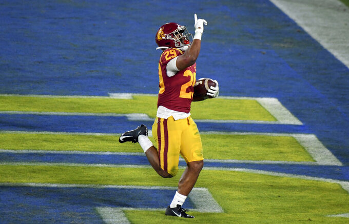 Southern California running back Vavae Malepeai celebrates a touchdown against UCLA during the second half of an NCAA college football game Saturday, Dec. 12, 2020, in Pasadena, Calif. (Keith Birmingham/The Orange County Register via AP)