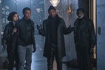 This image released by Warner Bros. Pictures shows from left, Alexandra Shipp, Jessie Usher, Samuel Jackson and Richard Roundtree in a scene from