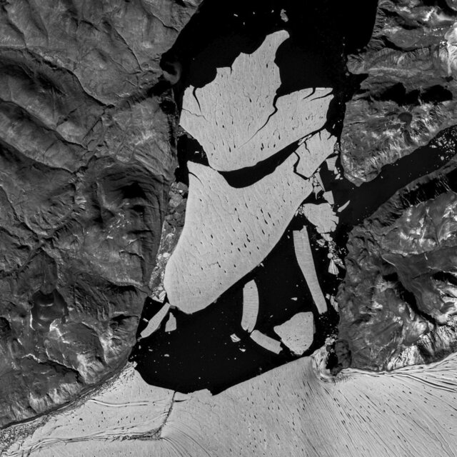 In this image proved by the European Space Agency, ESA, showing the glacier section that broke off the fjord called Nioghalvfjerdsfjorden, bottom, which is roughly 80 kilometers (50 miles) long and 20 kilometers (12 miles) wide, the National Geological Survey of Denmark and Greenland said Monday Sept. 14, 2020. The glacier is at the end of the Northeast Greenland Ice Stream, where it flows off land and into the ocean. Scientists with National Geological Survey see it as evidence of rapid climate change leading to the disintegration of the Arctic's largest remaining ice shelf. (European Space Agency via AP)