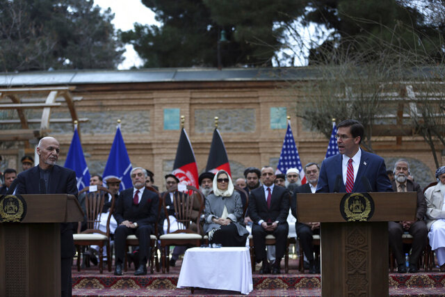 U.S. Secretary of Defense Mark Esper, right, and Afghan President Ashraf Ghani, speaks during a joint news conference in presidential palace in Kabul, Afghanistan, Saturday, Feb. 29, 2020. The U.S. is poised to sign a peace agreement with Taliban militants on Saturday aimed at bringing an end to 18 years of bloodshed in Afghanistan and allowing U.S. troops to return home from America's longest war. (AP Photo/Rahmat Gul)