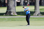 Viktor Hovland of Norway hits onto the 14th green during the third round of the Rocket Mortgage Classic golf tournament, Saturday, July 4, 2020, at the Detroit Golf Club in Detroit. (AP Photo/Carlos Osorio)