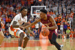 Florida State's Trent Forest, right, drives against Clemson's Tevin Mack during the first half of an NCAA college basketball game Saturday, Feb. 29, 2020 in Clemson, S.C. (AP Photo/Richard Shiro)