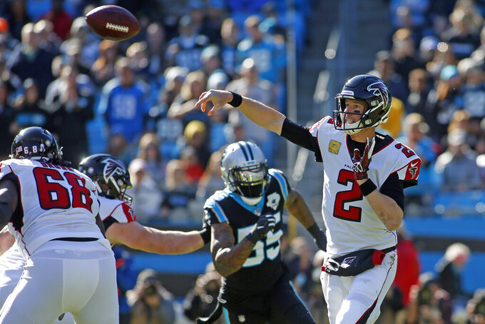 Atlanta Falcons quarterback Matt Ryan (2) passes against the Carolina Panthers during the first half of an NFL football game in Charlotte, N.C., Sunday, Nov. 17, 2019. (AP Photo/Brian Blanco)