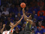 Baylor guard Devonte Bandoo (2) takes a shot over Florida guard Tre Mann (1) during the first half of an NCAA college basketball game Saturday, Jan. 25, 2020, in Gainesville, Fla. (AP Photo/Matt Stamey)