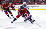 Washington Capitals defenseman Michal Kempny (6), from the Czech Republic, skates with the puck with Tampa Bay Lightning center Cedric Paquette (13) behind him during the first period of Game 3 of the NHL Eastern Conference finals hockey playoff series, Tuesday, May 15, 2018, in Washington. (AP Photo/Alex Brandon)