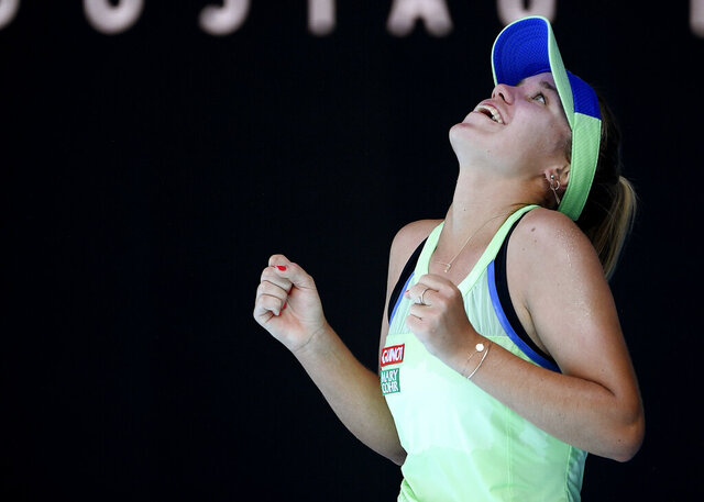 Sofia Kenin of the U.S. reacts after defeating Australia's Ashleigh Barty during their semifinal match at the Australian Open tennis championship in Melbourne, Australia, Thursday, Jan. 30, 2020. (AP Photo/Andy Brownbill)