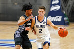 Villanova's Collin Gillespie, right, tries to get past Georgetown's Dante Harris during the first half of an NCAA college basketball game, Sunday, Feb. 7, 2021, in Villanova, Pa. (AP Photo/Matt Slocum)