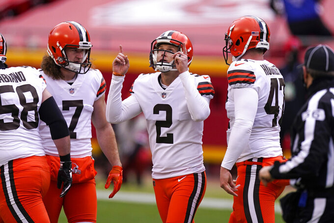 Cleveland Browns place kicker Cody Parkey (2) celebrates after kicking a 46-yard field goal during the first half of an NFL divisional round football game against the Kansas City Chiefs, Sunday, Jan. 17, 2021, in Kansas City. (AP Photo/Charlie Riedel)