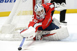 Washington Capitals goaltender Braden Holtby (70) bats away the puck during the first period of an NHL hockey game against the Los Angeles Kings, Tuesday, Feb. 4, 2020, in Washington. (AP Photo/Nick Wass)