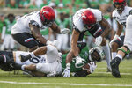 Marshall running back Brenden Knox (20) is brought down on a carry by Cincinnati defenders an NCAA college football game on Saturday, Sept. 28, 2019, in Huntington, W.Va. (Sholten Singer/The Herald-Dispatch via AP)