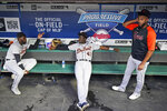 Detroit Tigers' Akil Baddoo, left to right, Derek Holland and Willi Castro talk during a rain delay before a baseball game against the Cleveland Indians, Tuesday, June 29, 2021, in Cleveland. (AP Photo/Tony Dejak)