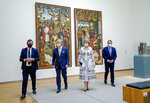 Belgium's King Philippe, center left, and Belgium's Queen Mathilde, center right, wear face masks, to prevent the spread of coronavirus, as they visit the Royal Museum of Fine Arts in Brussels, Tuesday, May 19, 2020. Museums are hesitantly starting to reopen as the coronavirus lockdown measures are relaxed, yet experts say that one in eight in the world could potentially face permanent closure because of the pandemic. (Daina Le Lardic, Pool Photo via AP)