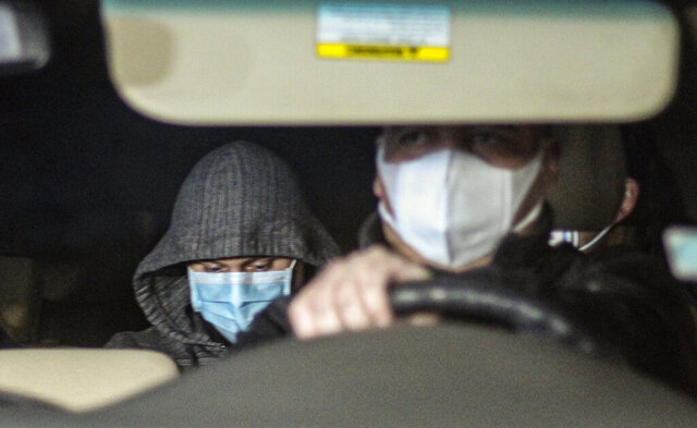 Nicolas Zepeda, left, is driven in a car by police investigators from his home where he was under house arrest, one day prior his extradition to France, in a Viña del Mar, Chile, Wednesday, July 22, 2020. Zepeda faces charges related to the 2016 murder of his former Japanese girlfriend Narumi Kurosaki. (AP Photo/Lucas Aguayo)