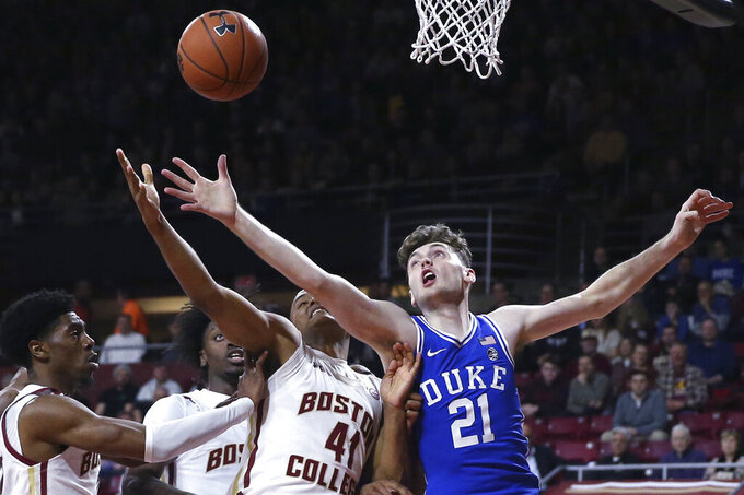 Duke forward Matthew Hurt (21) and Boston College forward Steffon Mitchell (41) battle for a loose ball during the first half of an NCAA college basketball game in Boston, Tuesday, Feb. 4, 2020. (AP Photo/Charles Krupa)