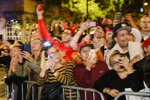 People react to revelers marching during the Greenwich Village Halloween Parade, Thursday, Oct. 31, 2019, in New York. (AP Photo/Frank Franklin II)
