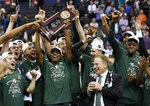 Michigan State guard Cassius Winston holds up the NCAA men's East Regional trophy as he celebrates with his team after defeating Duke in a college basketball game in Washington, Sunday, March 31, 2019. Michigan State won 68-67. (AP Photo/Alex Brandon)