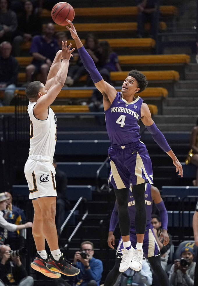 FILE - In this Feb. 28, 2019, file photo, Washington guard Matisse Thybulle (4) blocks a shot by California guard Matt Bradley (20) during the first half of an NCAA college basketball game, in Berkeley, Calif. Thybulle was named the Player of the Year in the Pac-12, Tuesday, March 12, 2019, by being a disruptive defensive force for the Pac-12 regular-season champions. (AP Photo/Tony Avelar, File)