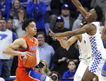 Florida's Andrew Nembhard, left, looks for an opening on Kentucky's Immanuel Quickley, right, during the second half of an NCAA college basketball game in Lexington, Ky., Saturday, March 9, 2019. Kentucky won 66-57. (AP Photo/James Crisp)