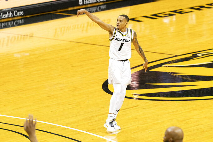 Missouri's Xavier Pinson watches a 3-point shot go in the basket during the second half of an NCAA college basketball game against TCU, Saturday, Jan. 30, 2021, in Columbia, Mo. Missouri won the game 102-98. (AP Photo/L.G. Patterson)