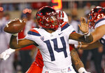 Arizona quarterback Khalil Tate throws a pass against Utah during the first half of an NCAA college football game Friday, Oct. 12, 2018, in Salt Lake City. (AP Photo/Rick Bowmer)