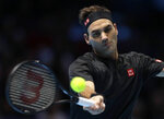 Roger Federer of Switzerland plays a return to Stefanos Tsitsipas of Greece during their ATP World Tour Finals semifinal tennis match at the O2 Arena in London, Saturday, Nov. 16, 2019. (AP Photo/Kirsty Wigglesworth)