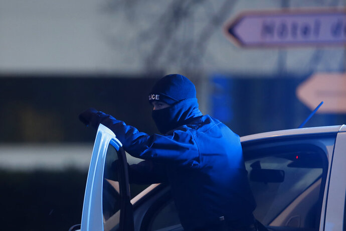 A French police officer stands guard in Strasbourg, eastern France, Thursday, Dec. 13, 2018. A top French official says a suspect has been killed in a shootout with police in Strasbourg, but hasn't been confirmed as the alleged gunman who killed three people near a Christmas market on Tuesday. (AP Photo/Christophe Ena)