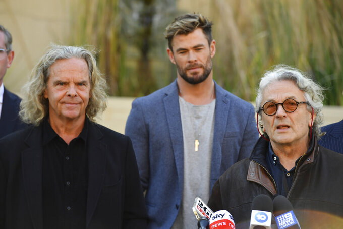 """From left, Producer Doug Mitchell, actor Chris Hemsworth and director George Miller attend at a press conference to announce the new """"Mad Max"""" film at Fox Studios Australia in Sydney, Monday, April 19, 2021. (Mick Tsikas/AAP Image via AP)"""