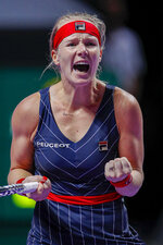 Kiki Bertens of the Netherlands celebrates after defeating Ashleigh Barty of Australia in their WTA Finals Tennis Tournament in Shenzhen, China's Guangdong province, Tuesday, Oct. 29, 2019. (AP Photo/Andy Wong)